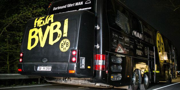 DORTMUND, GERMANY - APRIL 12: Team bus of the Borussia Dortmund football club damaged in an explosion...