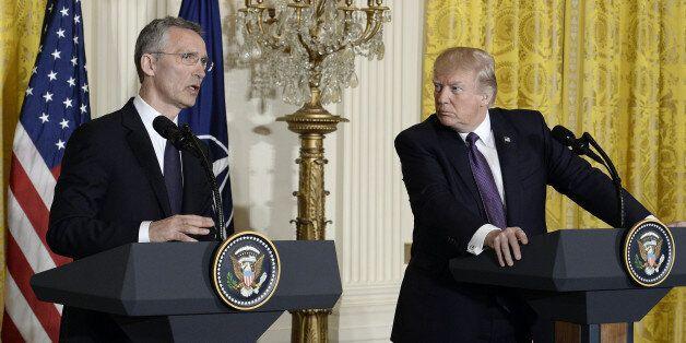 Jens Stoltenberg, secretary general of the North Atlantic Treaty Organization (NATO), left, speaks as...