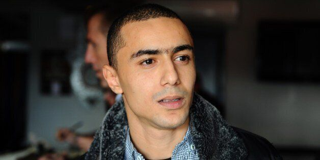 Tunisian rapper Ala Yaacoubi, better known by his rap name 'Weld El 15, arrives at the courthouse for...
