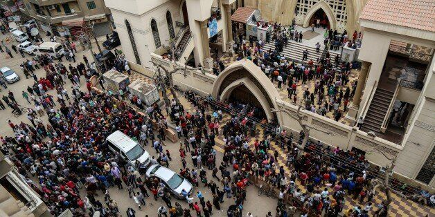 TANTA, EGYPT - APRIL 9: People gather in front of the Saint George church after a bombing struck inside...