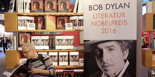 FRANKFURT AM MAIN, GERMANY - OCTOBER 19: A man reads a book about Bob Dylan at the 2016 Frankfurt Book...