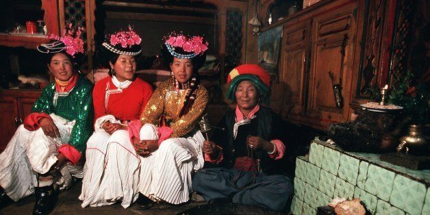CHINA - FEBRUARY 01: The Musuo Women'S Kingdom On January 2Nd, 2000, China. Musuo Mother And Her Young...