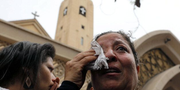 A relative of one of the victims reacts after a church explosion killed at least 21 in Tanta, Egypt,...