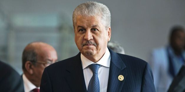 Algerian Prime Minister Abdelmalek Sellal stands at the African Union headquarters during a summit on...