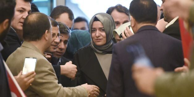 Turkey's Family Minister Fatma Betul Sayan Kaya (C) arrives at the Ataturk International airport on March...