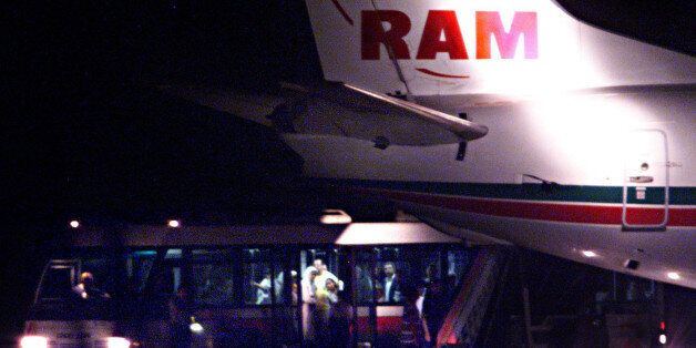 Hostages from the hijacked Royal Air Maroc airliner get on to buses at Barcelona Airport, August 26....