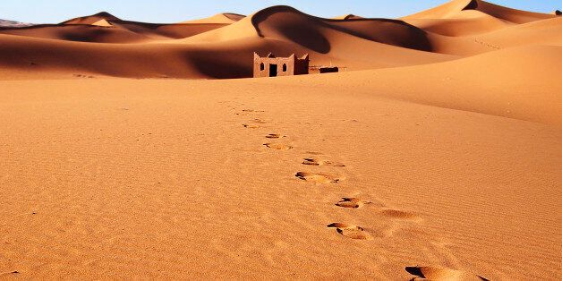 Erg Chebbi sandydunes of Sahara Desert at the evening,