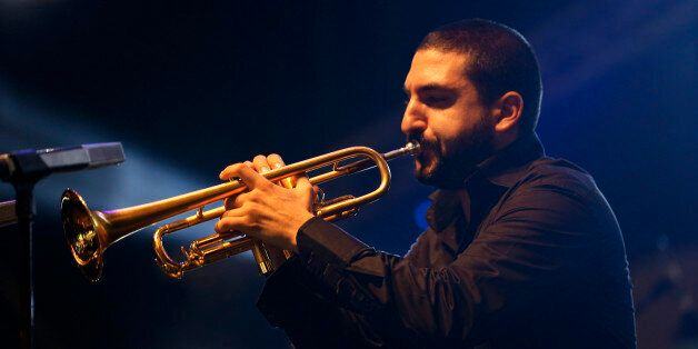 Trumpet player Ibrahim Maalouf performs during the 17th edition of the Gnaoua World Music Festival in...