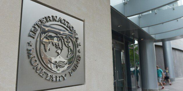 The seal of the International Monetary Fund is seen on a headquarters building in Washington, DC on July...