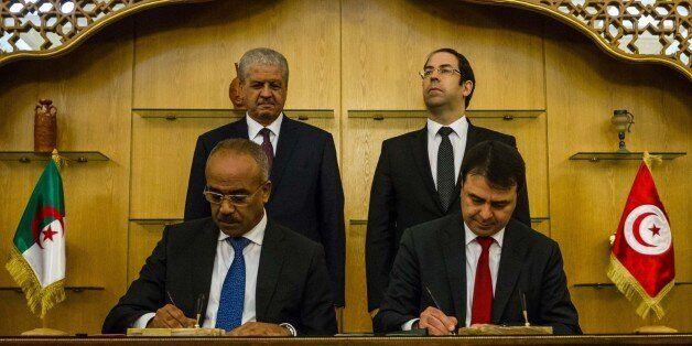 TUNIS, TUNISIA - MARCH 9: Algerian Prime Minister Abdelmalek Sellal (rear L) and Tunisian Prime Minister...