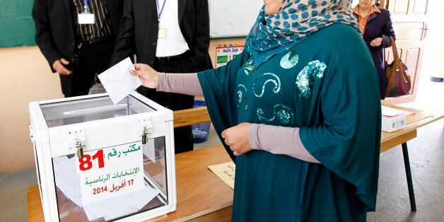 ALGIERS, ALGERIA - APRIl 17: An Algerian woman casts her ballot for Algeria's presidential election at...