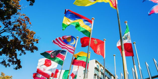 world flags in front of UNESCO headquarters in Paris,