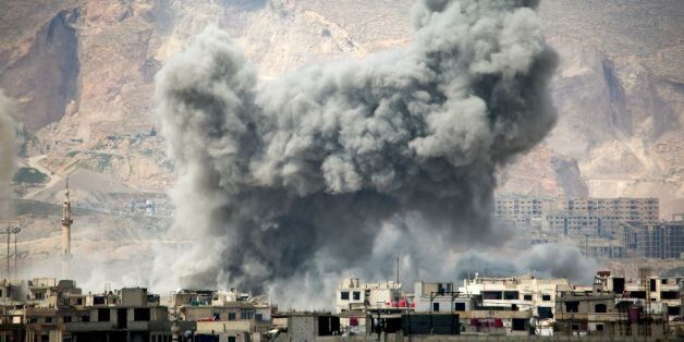 Smoke billows following a reported air strike in the rebel-held parts of the Jobar district, on the eastern...