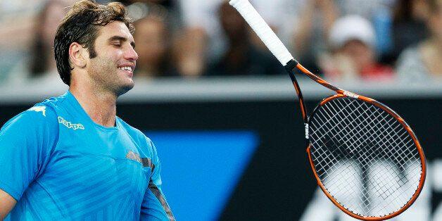 Malek Jaziri of Tunisia throws his racquet during his men's singles third round match against Nick Kyrgios...