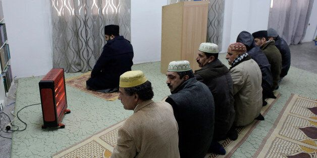 ATHENS, GREECE - FEBRUARY 5: Muslims pray at a Ahmadiyya Muslim Community makeshift mosque that was converted...