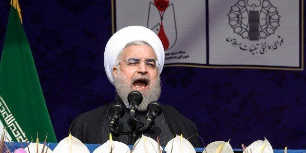 TEHRAN, IRAN - FEBRUARY 10: Iranian President Hassan Rouhani delivers a speech during a ceremony to mark...