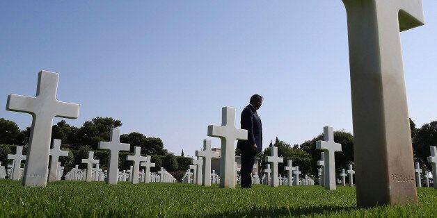 U.S. Secretary of Defense Leon Panetta tours the North Africa American Cemetery where 2,841 U.S. Soldiers...