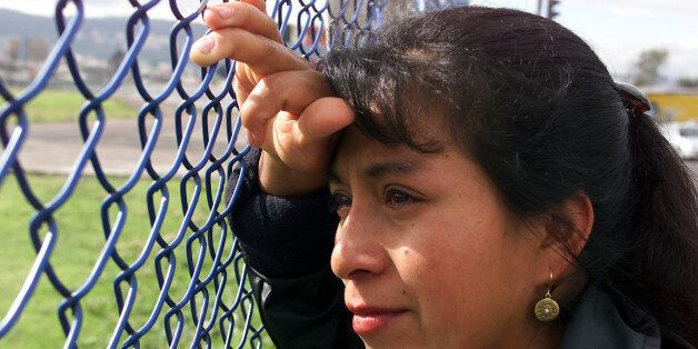 Ecuadorean Carmen Mainzanche bid farewell to her brother through thefence at the airport in Quito, April...