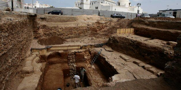 Archaeologists work at a dig at Martyrs' Square located in the low Casbah in Algiers' historical neighborhood...