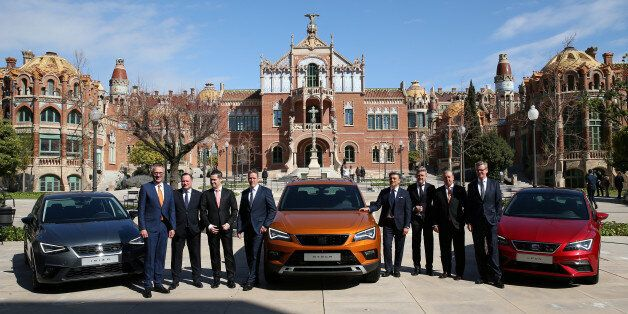 SEAT's President and CEO Luca de Meo (C) and board members pose during the presentation of the 2016 results...