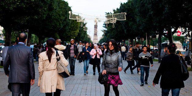 Pedestrians walk along Avenue Bourguiba in Tunis, Tunisia, on Wednesday, Nov. 2, 2011. Tunisia's government...