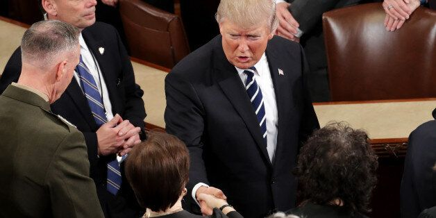 WASHINGTON, DC - FEBRUARY 28: U.S. President Donald Trump shakes hands with Supreme Court Justice Elena...