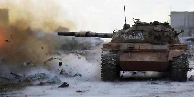 Members of the Libyan National Army (LNA) fire a tank during fighting against jihadists in Qanfudah,...