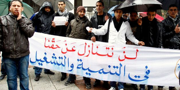 Unemployed graduates protest in front of the government office in Tunis January 30, 2012. Thirteen months...