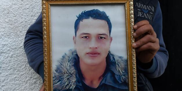 Walid Amri (back), the brother of 24-year-old Anis Amri, the prime suspect in Berlin's deadly truck attack,...