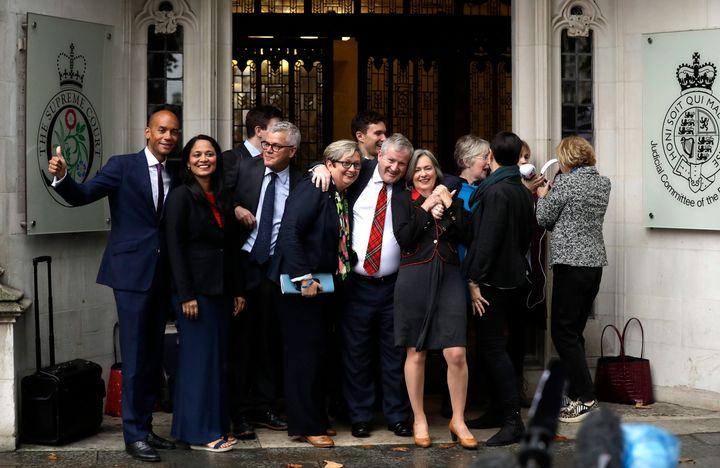Anti-Brexit campaigners celebrate the U.K. Supreme Court's decision on the legality of British Prime Minister Boris Johnson's five-week suspension of British parliament.