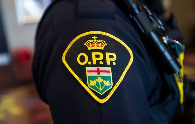 An Ontario Provincial Police officer stands at a news conference in Vaughan, Ont., on June 20,