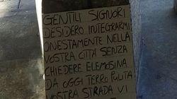 Migrante pulisce la strada a Mestre