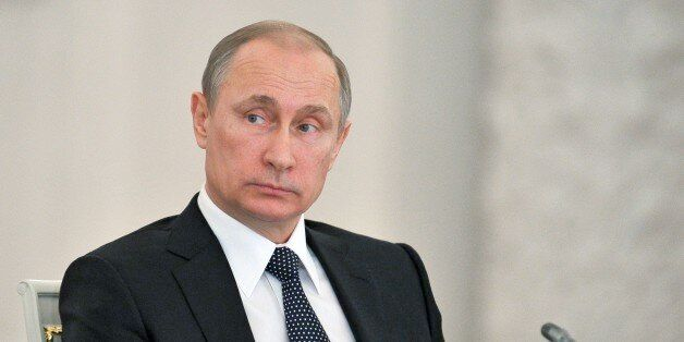 Russian President Vladimir Putin attends a meeting of the State Council in the Kremlin in Moscow, Russia,...