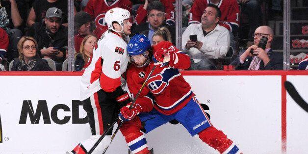 MONTREAL, QC - APRIL 15: Bobby Ryan #6 of the Ottawa Senators and Tom Gilbert #77 of the Montreal Canadiens...