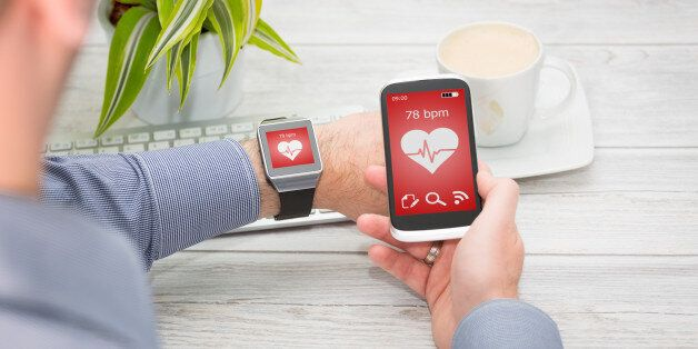 Businessman uses smart watch and phone. Smartwatch