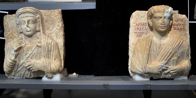 A picture taken on February 16, 2017 shows two funeral reliefs from Palmyra archeological site that will...