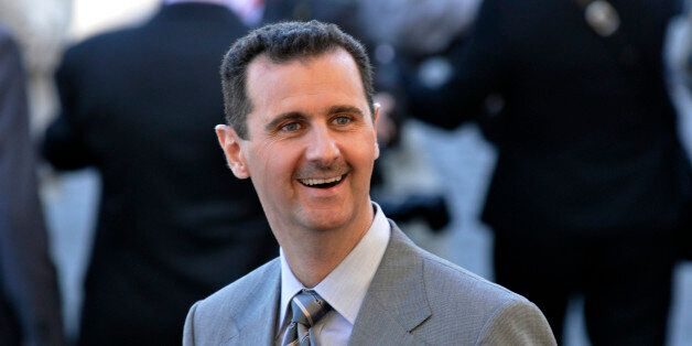 Syrian President Bachar al Assad attends the Bastille Day parade in Paris. (Photo by Alain Nogues/Corbis...