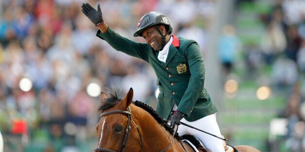 Abdelkebir Ouaddar of Morocco riding Quickly De Kreisker celebrates during the individual second round...