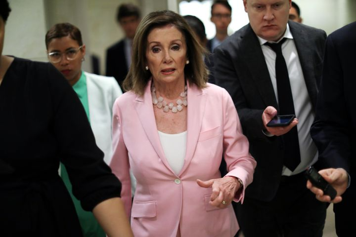 House Speaker Nancy Pelosi (D-Calif.) speaks with reporters following her weekly news conference on Capitol Hill, Sept. 12, 2