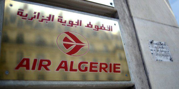 A photo taken on July 24, 2014 shows a plaque of an Air Algerie airlines office in Paris. Many French...