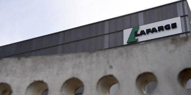 A picture shows the logo on a plant of French cement company Lafarge on April 7, 2014 in Paris. Swiss...