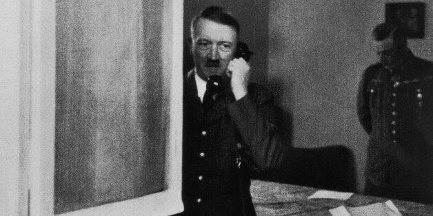 German Nazi leader Adolf Hitler (1889 - 1945) takes a phone call at Wolfsschlucht I - his headquarters...