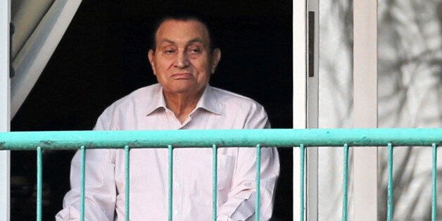 Ousted Egyptian president Hosni Mubarak looks towards his supporters outside the area where he is hospitalized...