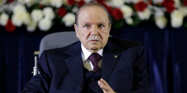 President Abdelaziz Bouteflika gestures during a swearing-in ceremony in Algiers April 28, 2014. Bouteflika...