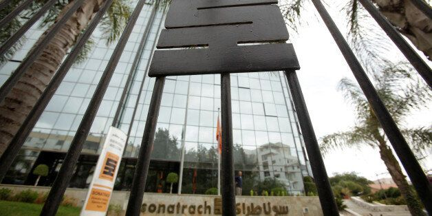 the logo of The state energy company Sonatrach is pictured on a gate outside of the the headquarters...