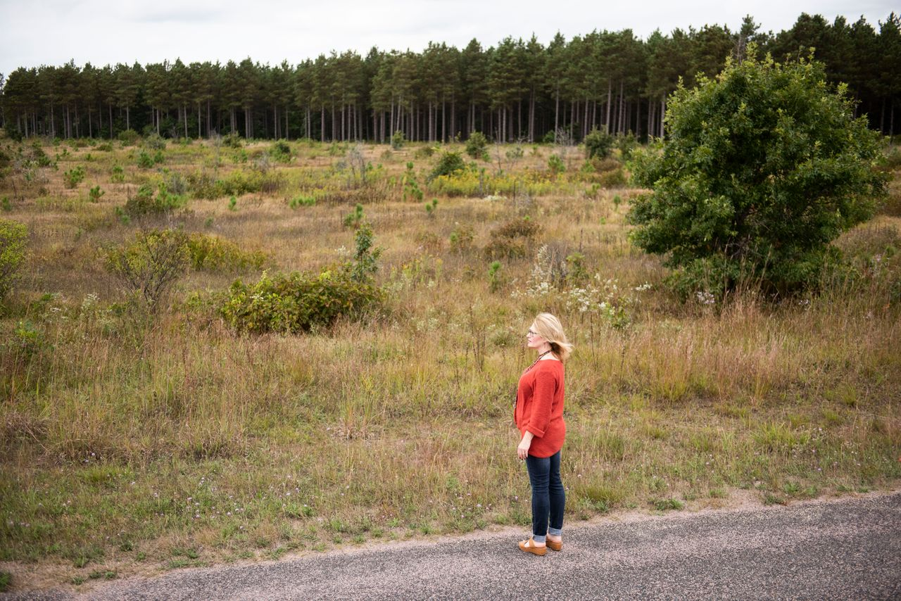 Carrell looks out over a portion of the proposed site of Golden Sands Dairy in Saratoga, Wisconsin, on Sept. 20.