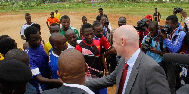 KAMPALA, UGANDA - FEBRUARY 25: FIFA President Gianni Infantino speaks with young footballers during his...