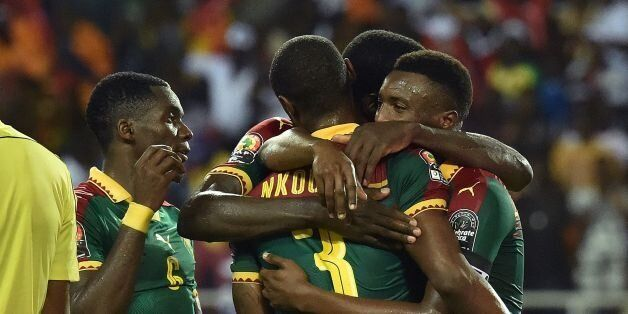 Cameroon's defender Nicolas Nkoulou is congratulated by team mates after scoring a goal during the 2017...