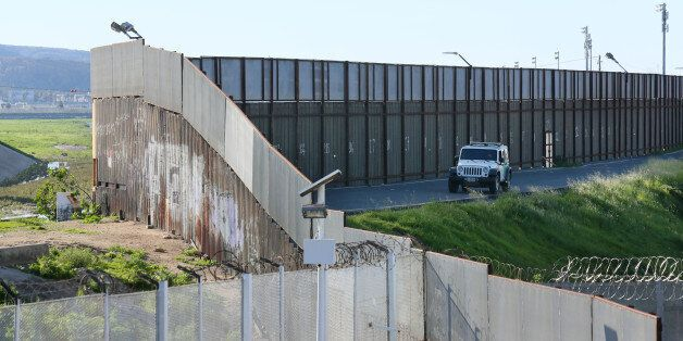 SAN YSIDRO, CALIFORNIA - JANUARY 25: A Border Patrol vehicle sits along the U.S.-Mexico border wall on...