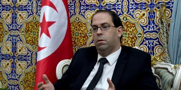 Tunisia's premier-designate Youssef Chahed sits in his office before giving a press conference to present...